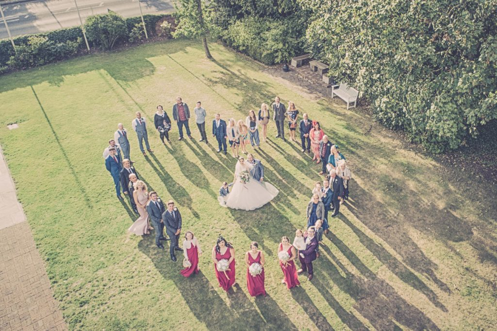 The Bride and Groom in a love heart shot with the drone