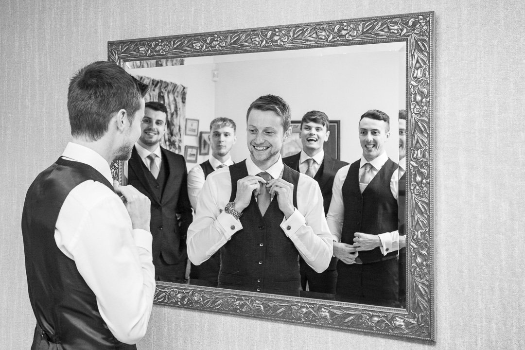 Groomsmen getting ready for the wedding at Rudding Park