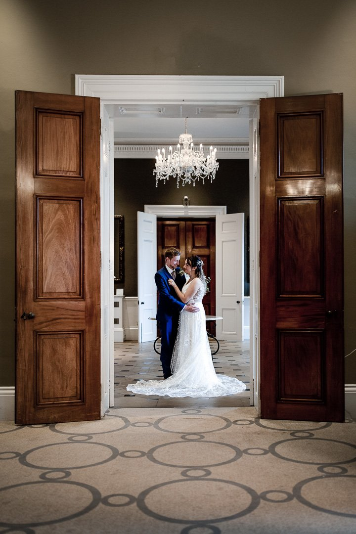 Bride and Groom pose in a doorway at Rudding Park