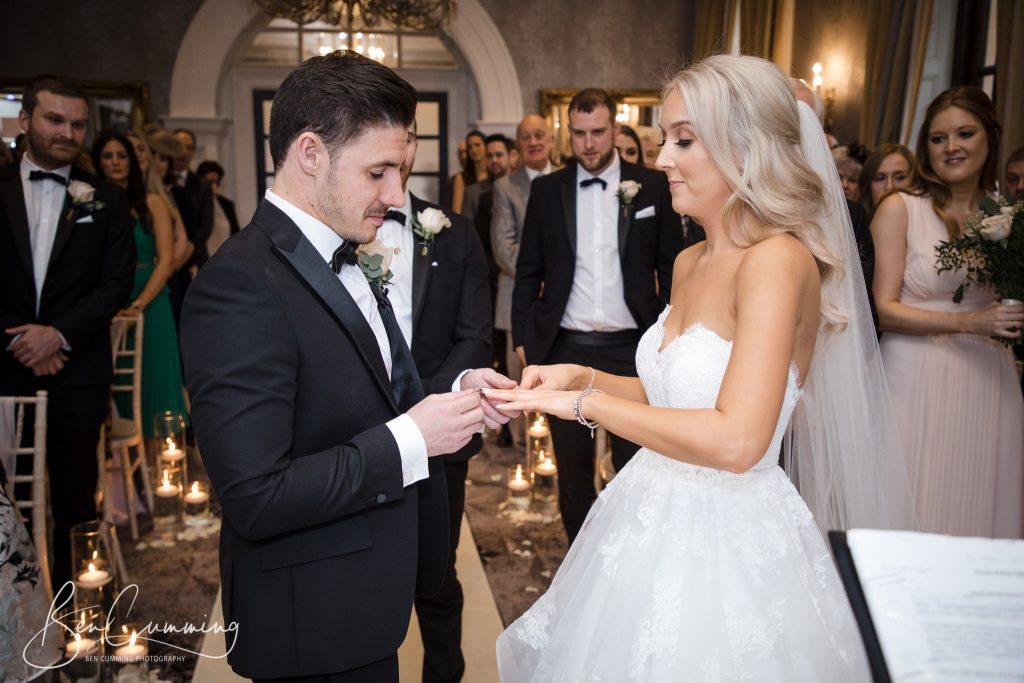 The Groom puts the wedding ring on his wifes finger at Oulton Hall