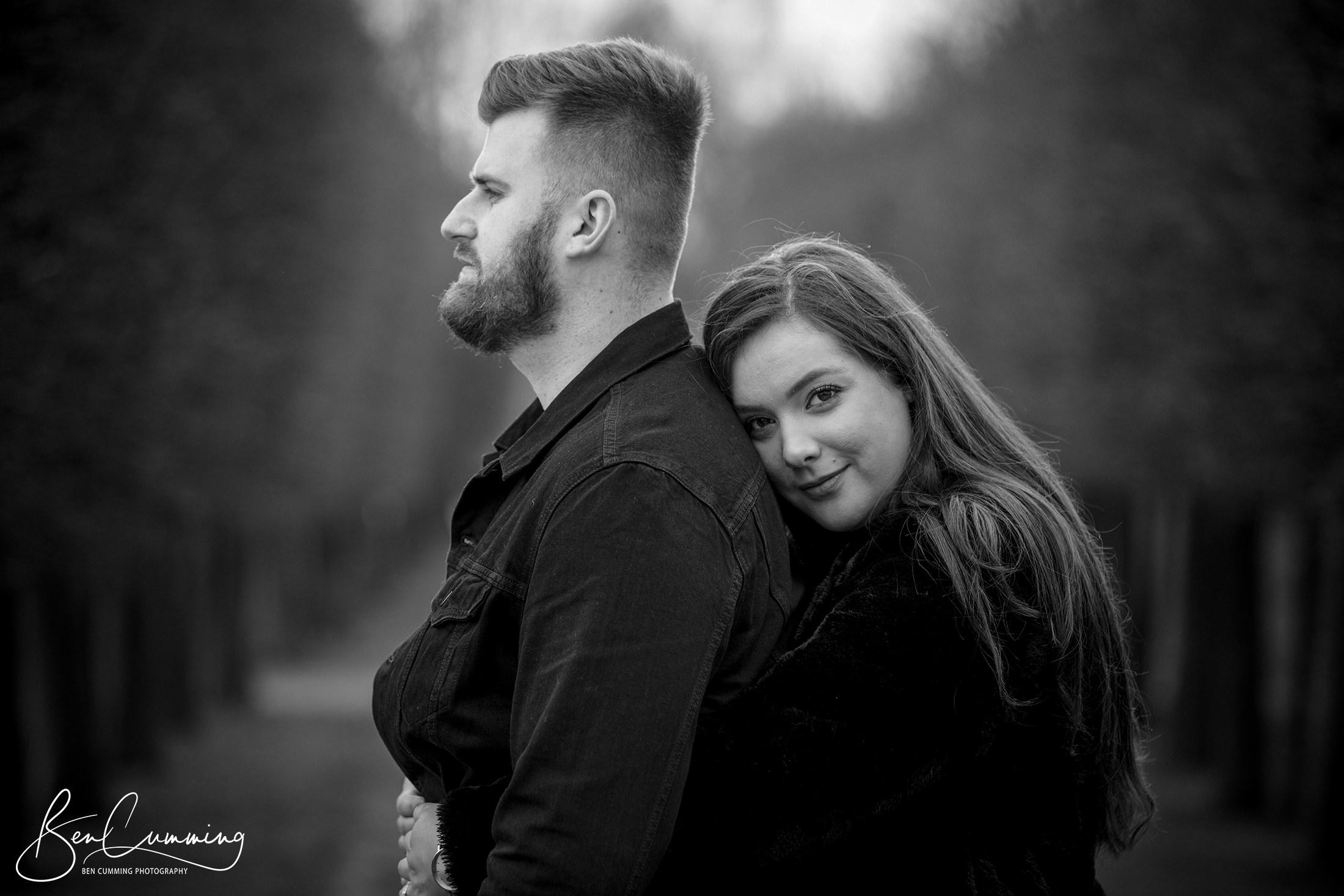 A couple pose for a romantic pre wedding photo