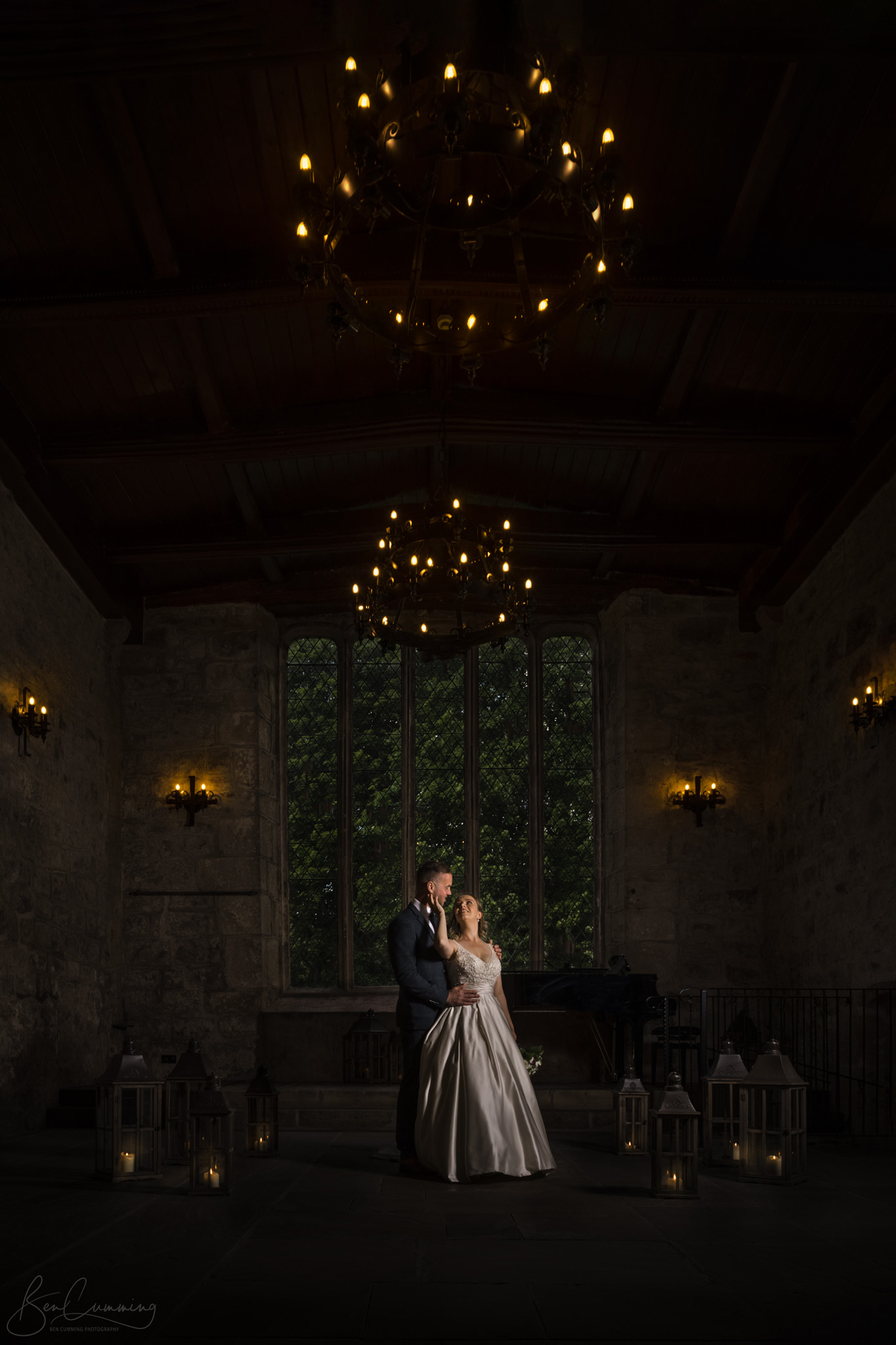 Bride and Groom Pose in the Old Chapel